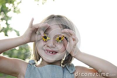 Little girl with sunflower eyes