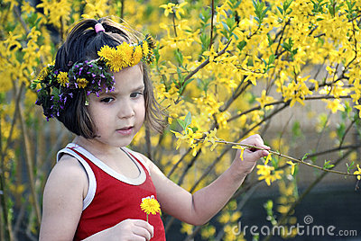 Little girl surrounded by flowers