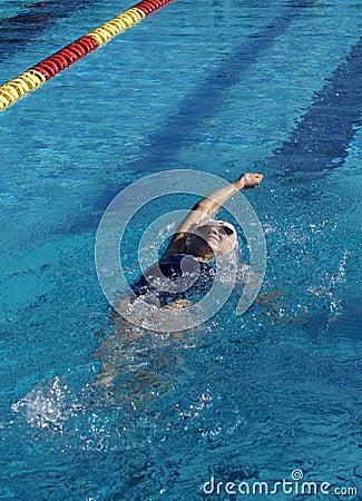 Little Girl Swimming Backstroke