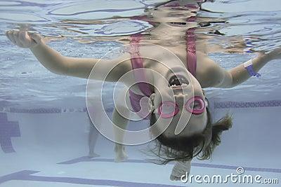 Little Girl Swims Under Water