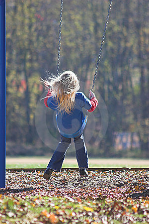Free Little Girl Swinging Royalty Free Stock Photography - 350317