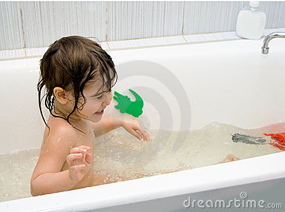 Little girl take a bath