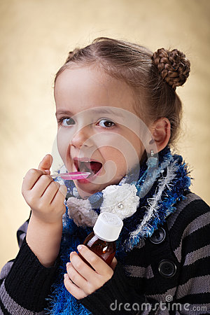 Free Little Girl Taking Cough Medicine Syrup Stock Photography - 29812732