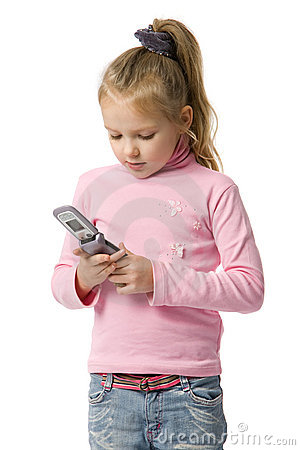 Little girl talks by mobile phone
