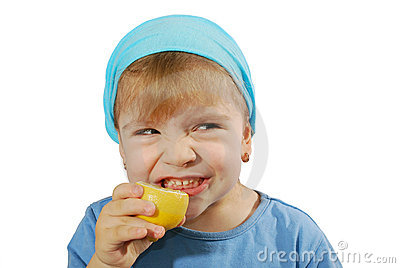 Little girl taste lemon