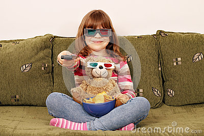 Little girl and teddy bear with 3d glasses