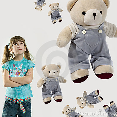 Little girl with teddy-bears