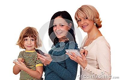 Little girl  teenage girl and woman with phones