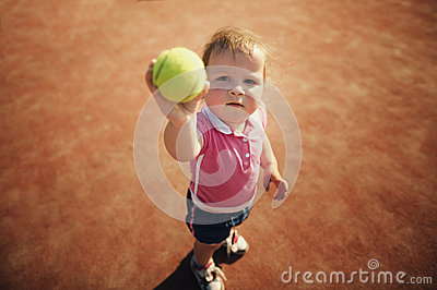 Little girl with tennis ball
