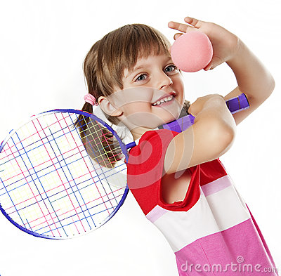 Little girl with a tennis racket and ball