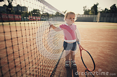 Little girl with tennis racket
