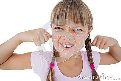 Little girl tensing her arm muscles