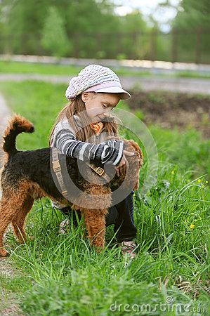Little girl with terrier