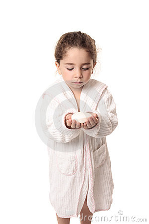 Little girl about to wash her hands with soap