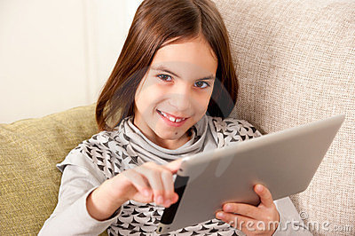 Little girl  with touch tablet computer