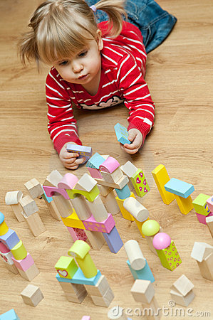 Little girl with toy blocks