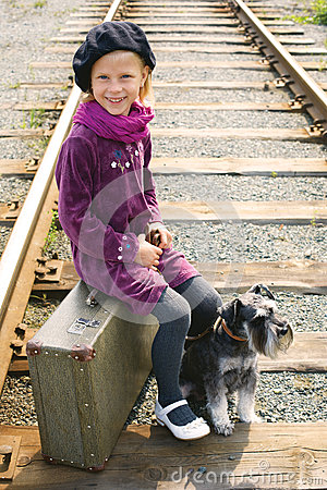 Little girl traveling with a dog