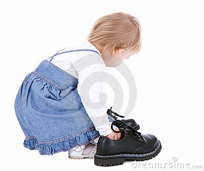 Little girl trying her mother s shoes