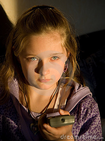 Little girl with TV remote