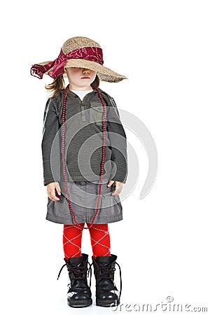 Little girl under big hat