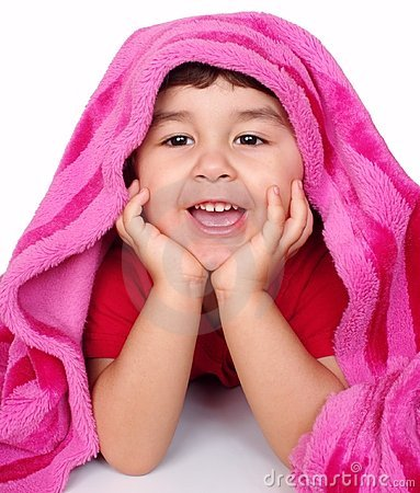 Little girl under pink blanket