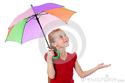 Little girl under umbrella looking up