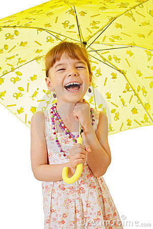 Little girl under yellow umbrella