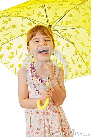 Little girl under yellow umbrella