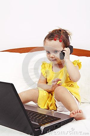 Little girl using mobile phone
