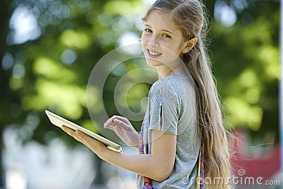 Little girl using PC tablet