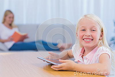 Little girl using tablet pc in the living room