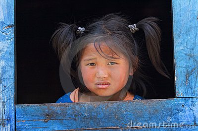 Little girl from the village of tibetan refugees Editorial Stock Photo
