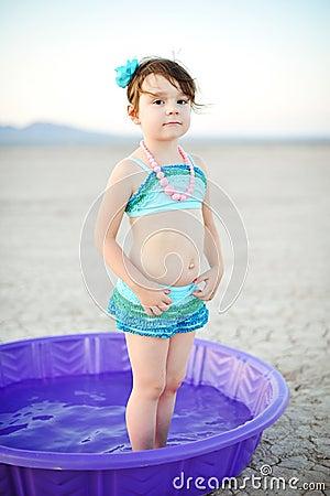 Little Girl Vintage Bathing Suit in Plastic Pool