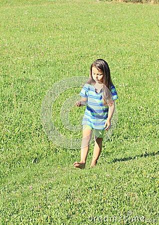 Little girl walking barefoot