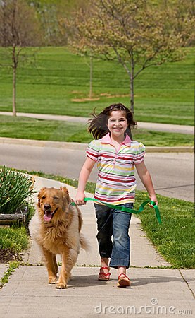 Free Little Girl Walking Dog Stock Photo - 5121590