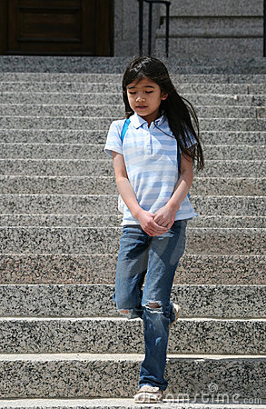 Little girl walking down  steps
