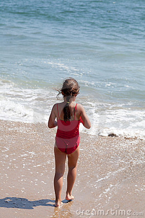 Free Little Girl Walking Into The Ocean On The Beach Royalty Free Stock Photography - 23405037