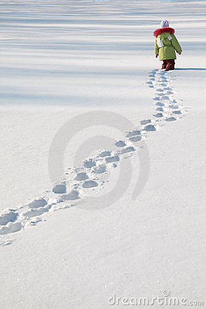 Little girl walking on snow