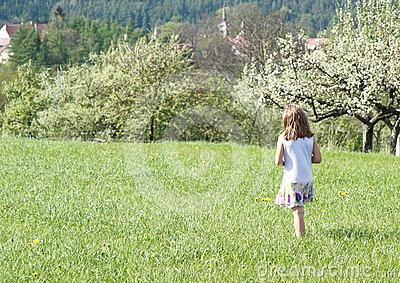 Little girl walking in spring
