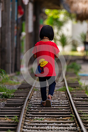 Free Little Girl Walks On The Railway Royalty Free Stock Photo - 65551525