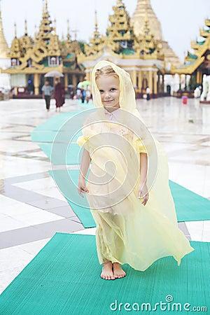 Little girl walks round the Shwedagon pagoda