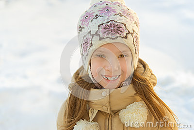 Little girl in warm coat with hood