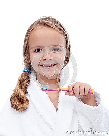 Little girl washing teeth - oral hygiene