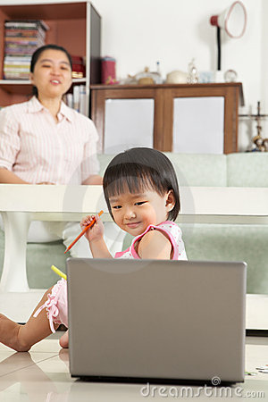 Little girl watching laptop