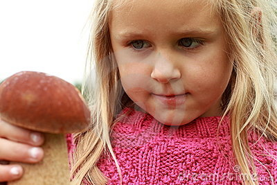 Little girl watching the mushroom