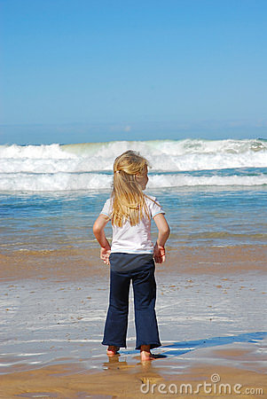 Little girl watching sea