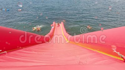 Little girl on water attraction during summer holiday. Little girl on water attraction during summer holiday stock video