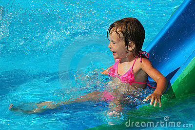 The little girl in water pool
