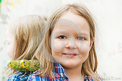 Little girl and wavy parrot