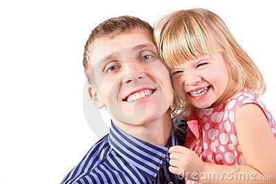 Little girl wearing dress is cuddle her father